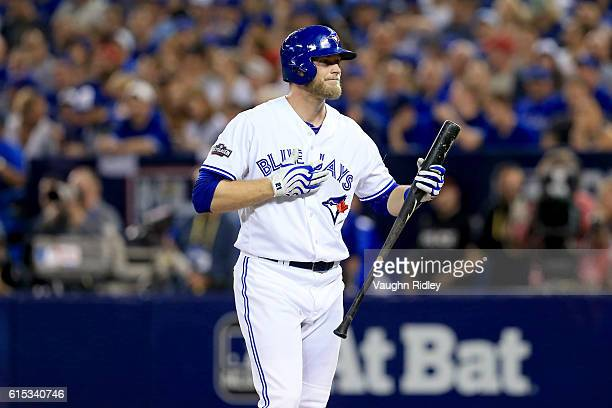 Michael Saunders of the Toronto Blue Jays reacts against the Cleveland Indians during game three of the American League Championship Series at Rogers...