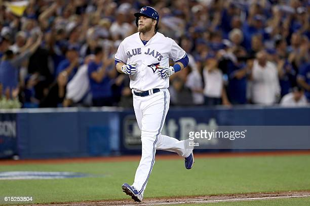Michael Saunders of the Toronto Blue Jays rounds the bases after hitting a solo home run in the second inning against Dan Otero of the Cleveland...