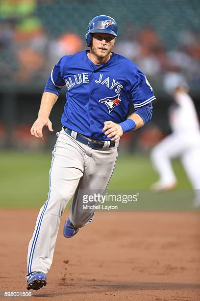 Michael Saunders of the Toronto Blue Jays rounds third and scores on Kevin Pillar of the Toronto Blue Jays single in the second inning during a...