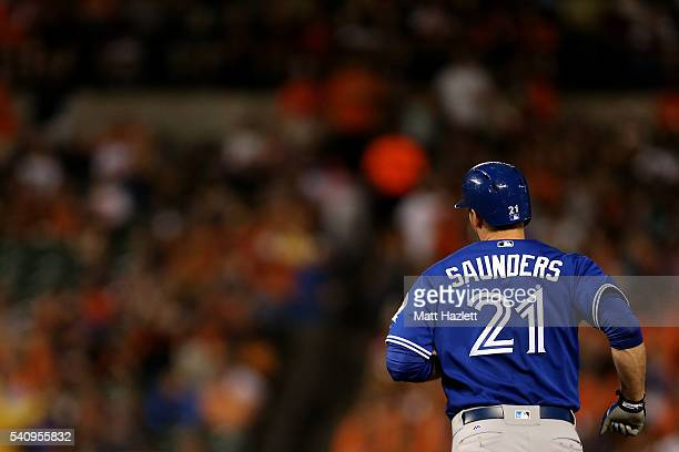 Michael Saunders of the Toronto Blue Jays runs the bases after hitting a tworun home run in the sixth inning against the Baltimore Orioles at Oriole...