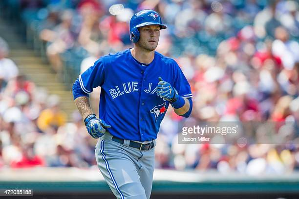 Michael Saunders of the Toronto Blue Jays runs to first after being walked during the third inning against the Cleveland Indians at Progressive Field...