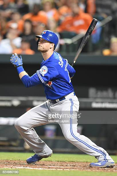 Michael Saunders of the Toronto Blue Jays takes a swing during a baseball game against the Baltimore Orioles at Oriole Park at Camden Yards on April...