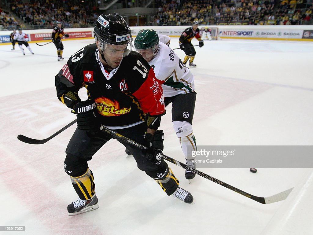 Michael Schiechl (Capitals) and Martin Ryoemark (Faerjestad). in action during the Champions Hockey League group stage game between Vienna Capitals and Faerjestad Karlstad on August 21, 2014 in Vienna, Austria.