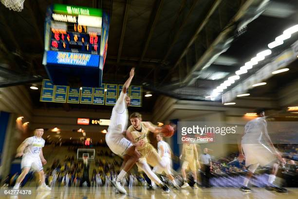 Michael Schlotman of the William Mary Tribe drives against Barnett Harris of the Delaware Fightin Blue Hens during the second half at the Bob...