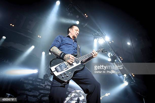 Michael Schon Poulsen of Volbeat performs on stage at Olympiahalle on November 13 2013 in Munich Germany
