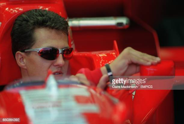 Michael Schumacher adjusts his wing mirrors as he prepares his car for qualifying