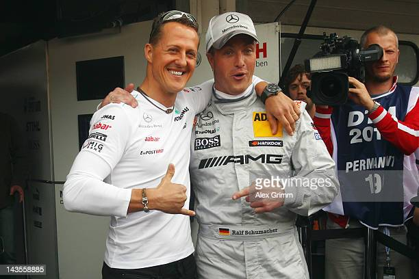 Michael Schumacher and his brother Ralf pose prior to the first race of the DTM German Touring Car Championship at Hockenheimring on April 29 2012 in...