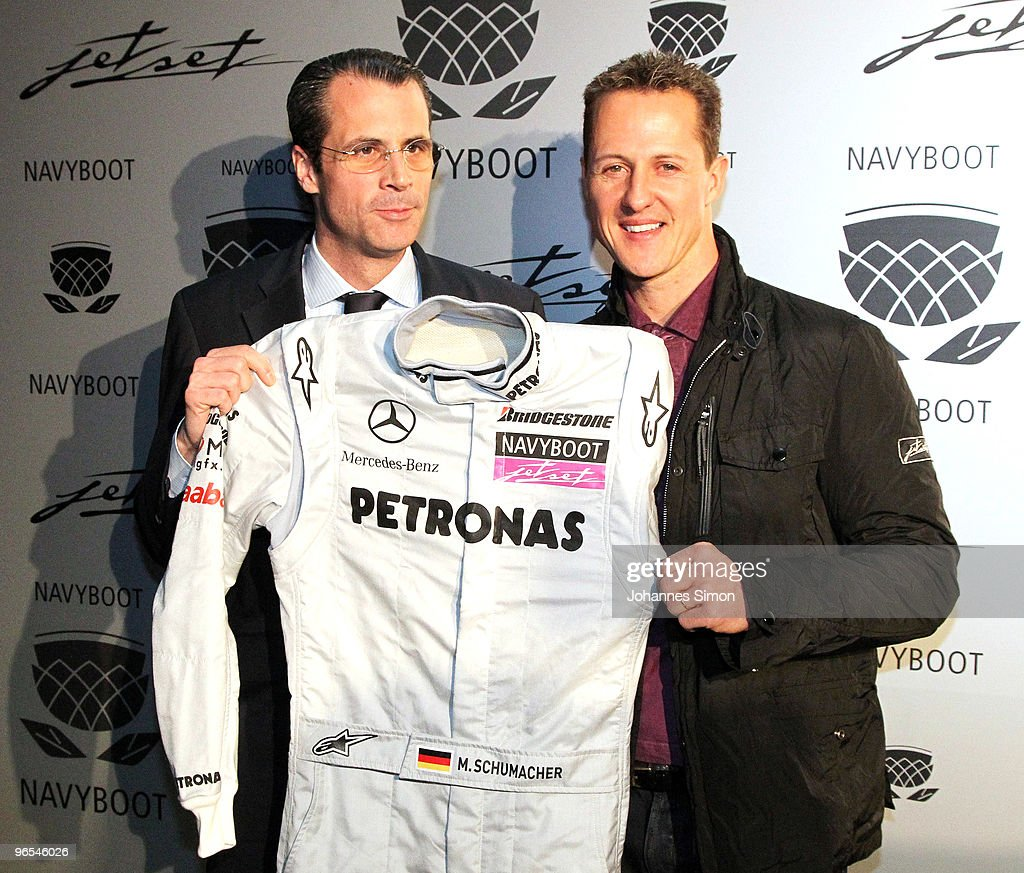 Michael Schumacher (R) and Philippe Gaydoul, CEO of Gaydoul Group pose during a press conference at P1 discotheque on February 10, 2010 in Munich, Germany.