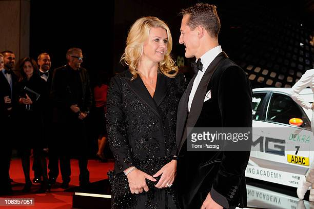 Michael Schumacher and wife Corinna Schumacher attend the GQ Men Of The Year 2010 award ceremony at Komische Oper on October 29 2010 in Berlin Germany