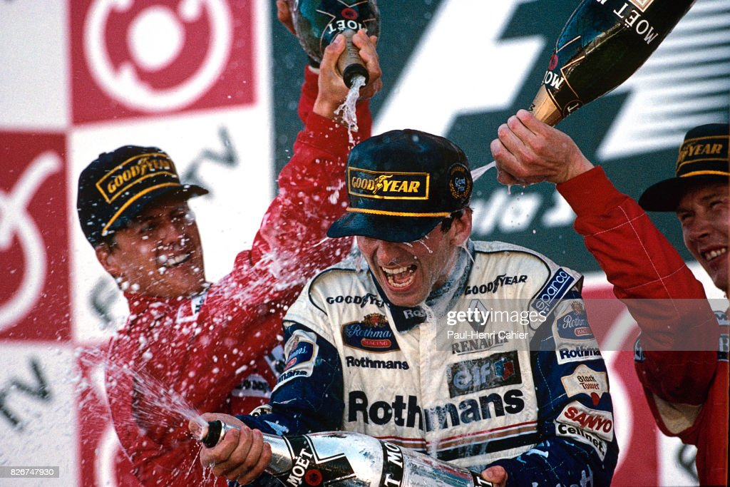 Michael Schumacher, Damon Hill, Mika Hakkinen, Grand Prix of Japan, Suzuka, 13 October 1996. Damon Hill was crowned World Champion by winning the Japanese Grand Prix.