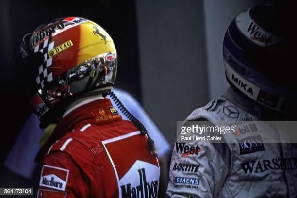 Michael Schumacher Mika Häkkinen Grand Prix of Japan Suzuka Circuit 01 November 1998 Mika Häkkinen and Michael Schumacher at the finish of the 1998...