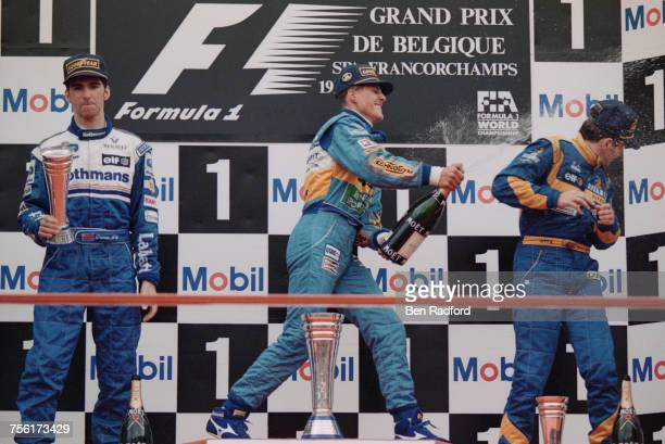Michael Schumacher of Germany and driver of the Mild Seven Benetton Renault Benetton B195Renault RS7 V10 sprays champagne over third placed Martin...