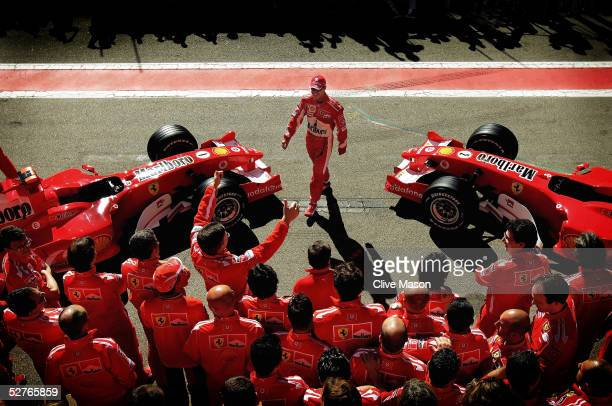 Michael Schumacher of Germany and Ferrari arrives for a Ferrari team photo prior to practice for the Formula One Spanish Grand Prix at the Circuit de...