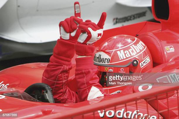 Michael Schumacher of Germany and Ferrari celebrates his pole position during qualifying for the Bahrain Formula One Grand Prix at the Bahrain...