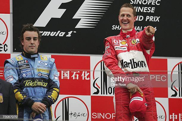 Michael Schumacher of Germany and Ferrari celebrates on the podium as Fernando Alonso looks on after the Formula One Chinese Grand Prix at Shanghai...