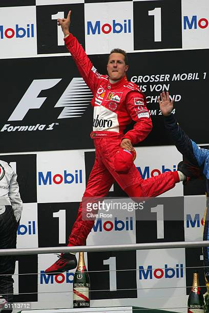 Michael Schumacher of Germany and Ferrari celebrates on the podium after winning the German F1 Grand Prix at the Hockenheim Circuit on July 25 in...