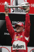 Michael Schumacher of Germany and Ferrari celebrates on the podium after winning the Formula One Chinese Grand Prix at Shanghai International Circuit...
