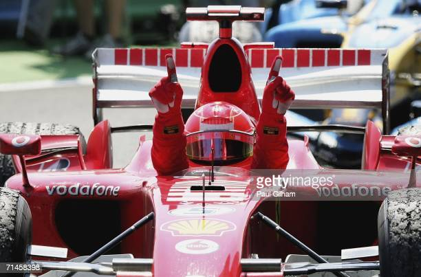 Michael Schumacher of Germany and Ferrari celebrates winning the French Formula One Grand Prix at the Nevers MagnyCours Circuit on July 16 2006 in...