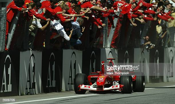 Michael Schumacher of Germany and Ferrari crosses the finish to win the Austrian Grand Prix on May 18 2003 at the A1 Ring in Spielberg Austria