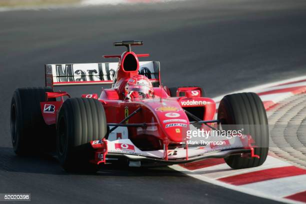 Michael Schumacher of Germany and Ferrari drives during Formula One testing at the Circuit De Catalunya on January 18 2004 in Barcelona Spain