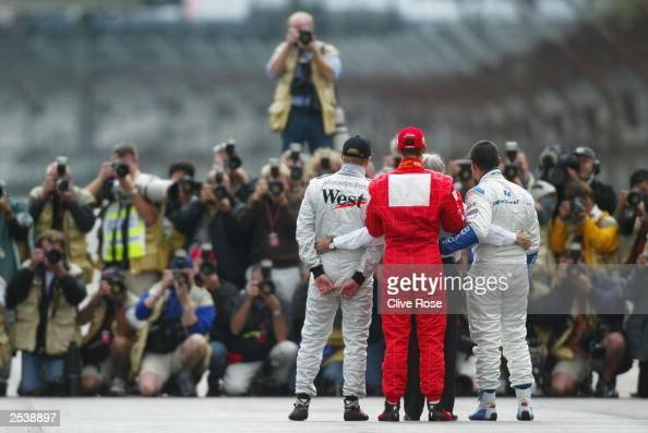 Michael Schumacher of Germany and Ferrari Kimi Raikonnen of Finland and McLaren Juan Pablo Montoya of Columbia and Williams and Bernie Ecclestone...