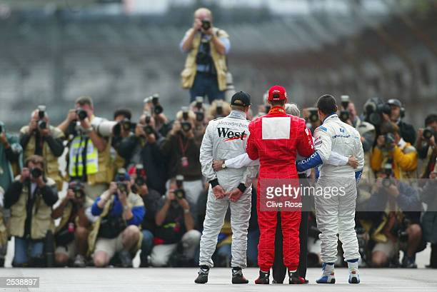 Michael Schumacher of Germany and Ferrari Kimi Raikonnen of Finland and McLaren Juan Pablo Montoya of Columbia and Williams and Bernie Ecclestone...