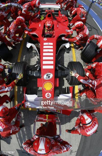 Michael Schumacher of Germany and Ferrari makes a pitstop during the Formula One British Grand Prix on June 11 2006 at Silverstone England