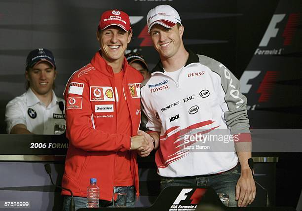 Michael Schumacher of Germany and Ferrari shakes hands with his brother Ralf Schumacher of Germany and Toyoto during the previews for the European F1...