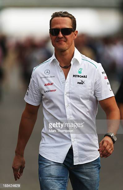 Michael Schumacher of Germany and Mercedes GP attends the drivers briefing following practice for the Japanese Formula One Grand Prix at the Suzuka...