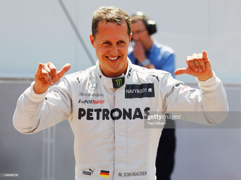 <a gi-track='captionPersonalityLinkClicked' href=/galleries/search?phrase=Michael+Schumacher&family=editorial&specificpeople=157602 ng-click='$event.stopPropagation()'>Michael Schumacher</a> of Germany and Mercedes GP celebrates setting the fastest time before his five place grid penalty during qualifying for the Monaco Formula One Grand Prix at the Circuit de Monaco on May 26, 2012 in Monte Carlo, Monaco.