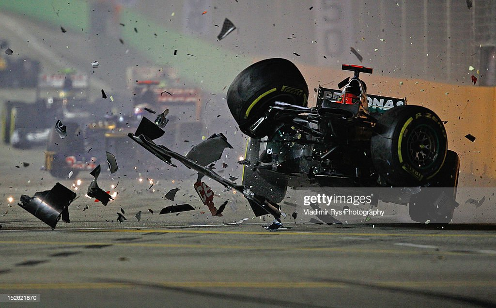 <a gi-track='captionPersonalityLinkClicked' href=/galleries/search?phrase=Michael+Schumacher&family=editorial&specificpeople=157602 ng-click='$event.stopPropagation()'>Michael Schumacher</a> of Germany and Mercedes GP crashes with <a gi-track='captionPersonalityLinkClicked' href=/galleries/search?phrase=Jean-Eric+Vergne&family=editorial&specificpeople=7077576 ng-click='$event.stopPropagation()'>Jean-Eric Vergne</a> of France and Scuderia Toro Rosso during the Formula One Grand Prix of Singapore at Marina Bay Street Circuit on September 23, 2012 in Singapore.