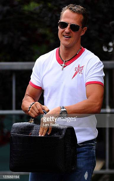 Michael Schumacher of Germany and Mercedes GP enters the paddock during previews to the Belgium Formula One Grand Prix at the Circuit of Spa...