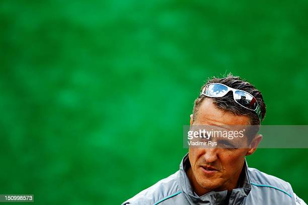Michael Schumacher of Germany and Mercedes GP is interviewed by the media during previews to the Belgian Grand Prix at the Circuit of Spa...