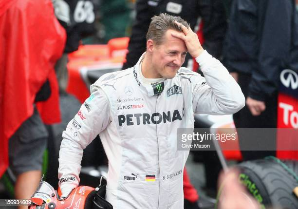 Michael Schumacher of Germany and Mercedes GP reacts in parc ferme after finishing his last F1 race following the Brazilian Formula One Grand Prix at...