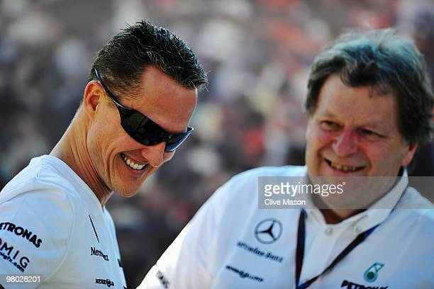 Michael Schumacher of Germany and Mercedes GP talks with Vice President of Mercedes Motorsport Norbert Haug in the paddock during previews to the...