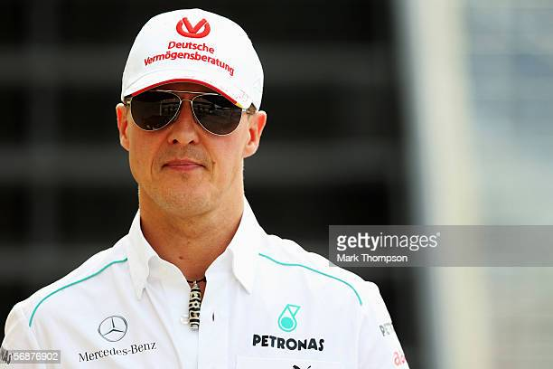 Michael Schumacher of Germany and Mercedes GP walks in the paddock following practice for the Brazilian Formula One Grand Prix at the Autodromo Jose...
