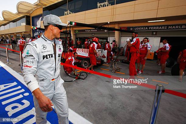 Michael Schumacher of Germany and Mercedes GP walks past the Ferrari garage in the pitlane before practice for the Bahrain Formula One Grand Prix at...