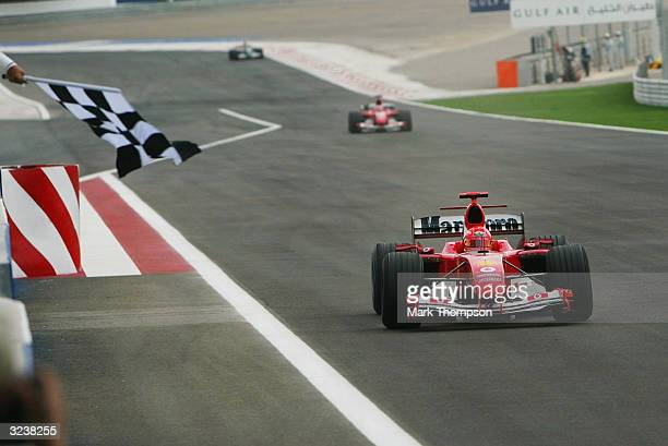 Michael Schumacher of Germany and the Ferrari Formula One team crosses the line to win the Bahrain F1 Grand Prix at the Bahrain Racing Circuit on...