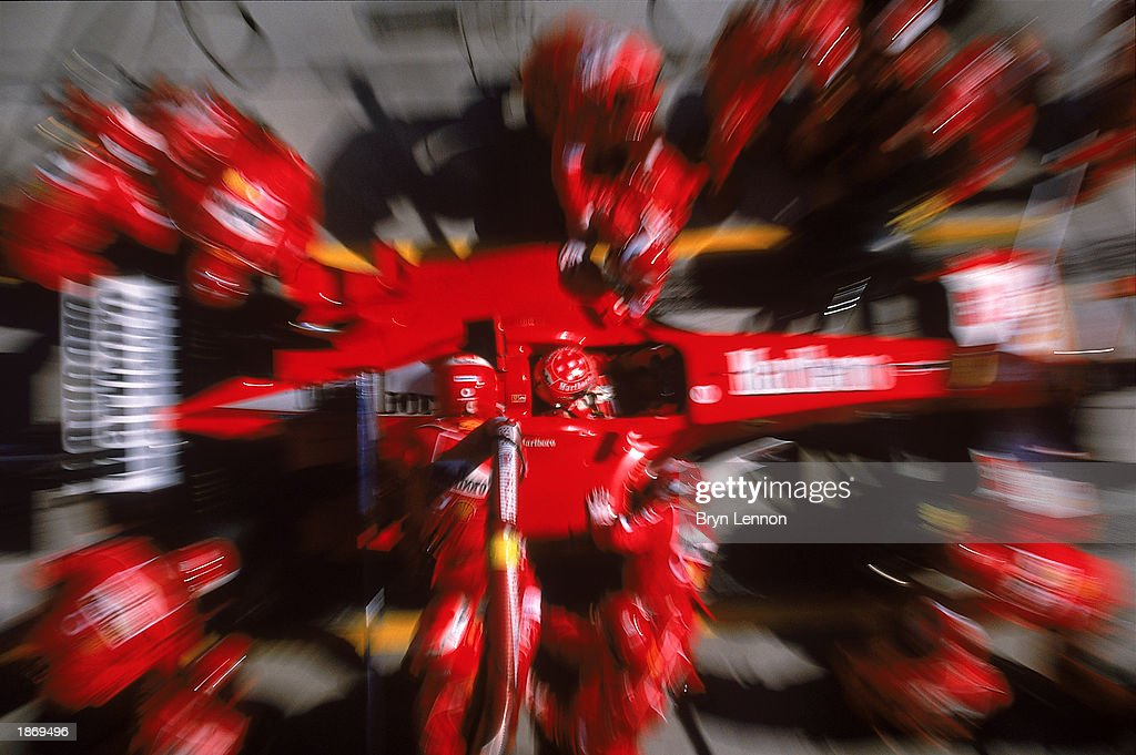 Michael Schumacher of Germany and the Ferrari team in the pits during the Formula One Malaysian Grand Prix held on March 23, 2003 at the Sepang International Circuit in Kuala Lumpur, Malaysia.