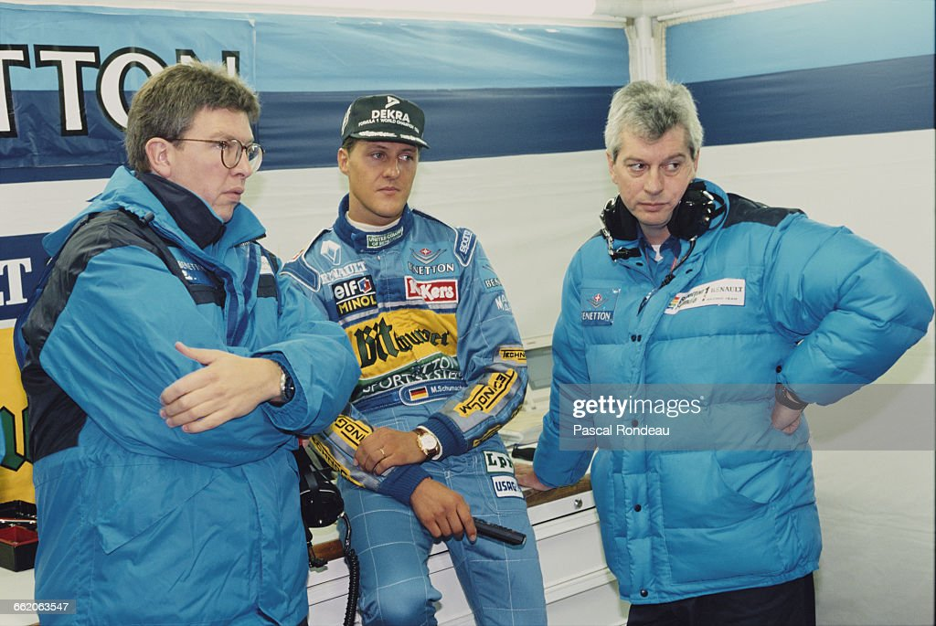 Michael Schumacher of Germany driver of the Mild Seven Benetton Ford Benetton B195 Renault V10 talking with team technical director Ross Brawn and...