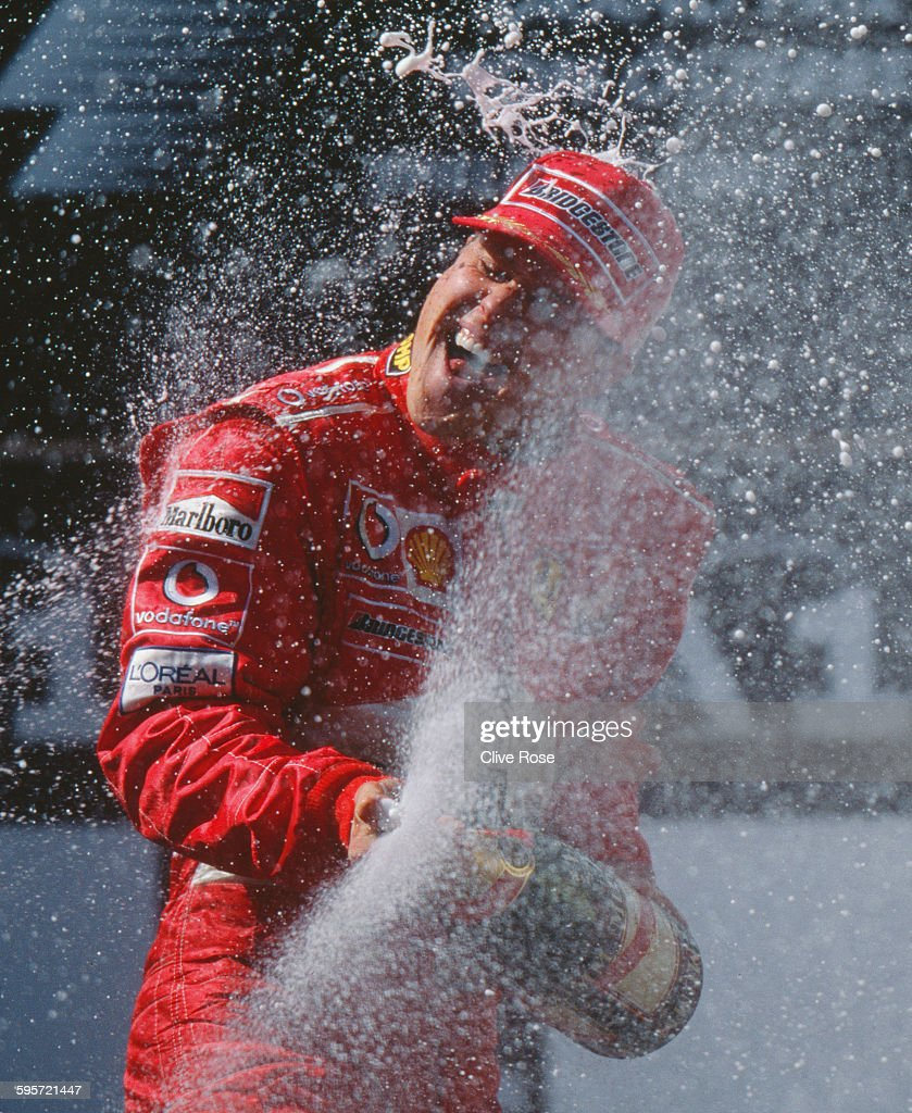 Michael Schumacher of Germany, driver of the #1 Scuderia Ferrari Marlboro Ferrari F2003-GA Ferrari V10 sprays champagne as he celebrates winning the Austrian Grand Prix on 18 May 2003 at the A1 Ring in Spielberg, Austria.
