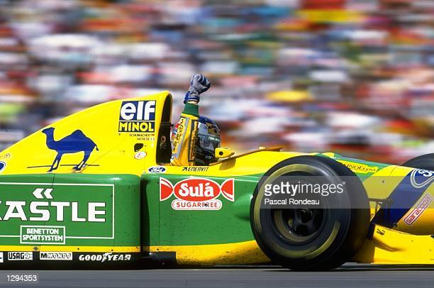 Michael Schumacher of Germany waves to the crowd after the German Grand Prix at the Hockenheim circuit in Germany Schumacher finished in second place...