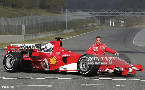 Michael Schumacher of Germany poses with the Ferrari 248 F1 during the launch of the new Ferrari F1 car for the Season 2006 on January 24 2006 in...