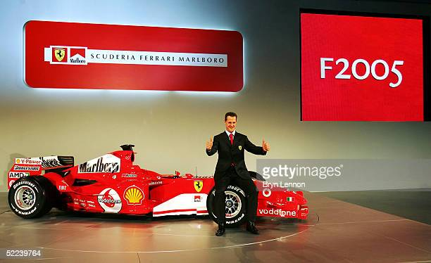 Michael Schumacher of Germany poses with the new Ferrari F2005 Formula One car at the Ferrari factory on February 25 2005 in Maranello Italy