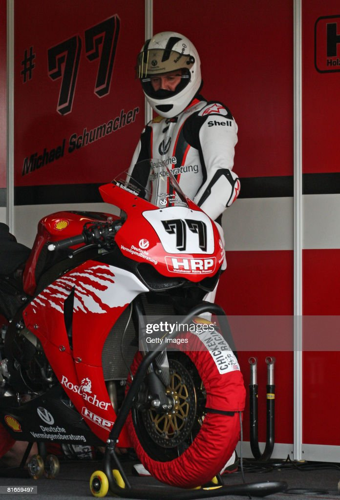 Michael Schumacher of Germany prepares to compete during the training session of the international German motorbike championships at the...