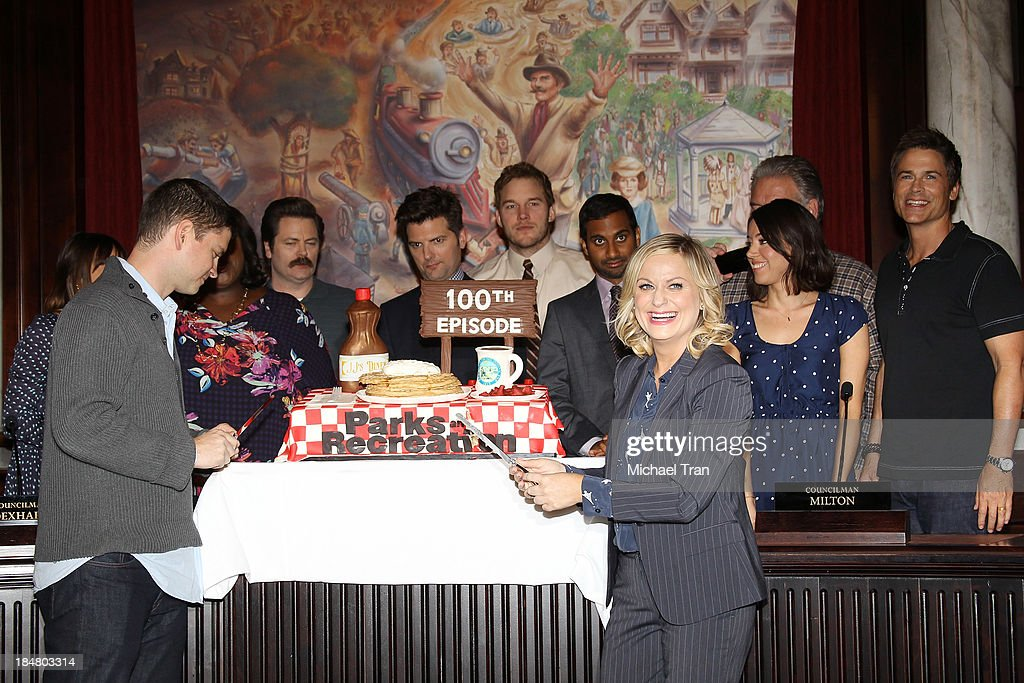 Michael Schur (L) with <a gi-track='captionPersonalityLinkClicked' href=/galleries/search?phrase=Amy+Poehler&family=editorial&specificpeople=228430 ng-click='$event.stopPropagation()'>Amy Poehler</a> and the cast of 'Parks And Recreation' attend their 100th episode celebration held at CBS Studios - Radford on October 16, 2013 in Studio City, California.