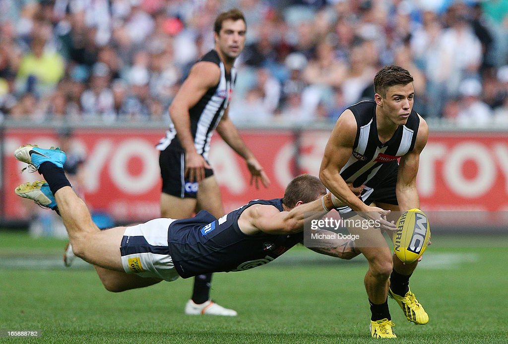 Michael Seedsman of the Magpies gets tackled by Zac Touhy of the Blues during the round two AFL match between the Collingwood Magpies and the Carlton Blues at Melbourne Cricket Ground on April 7, 2013 in Melbourne, Australia.
