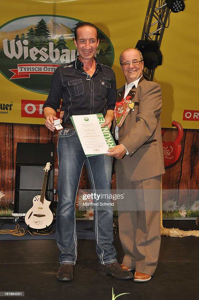 Michael Seida (L) ris presented with an award by Willy Turecek during the 'Wiener Wirten Tag' as part of Wiener Wiesn Festival 2013 on September 25, 2013 in Vienna, Austria.