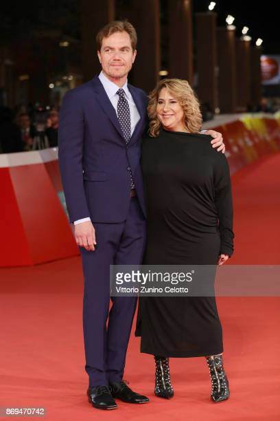Michael Shannon and Jennifer Lebeau walk a red carpet for 'Trouble No More' during the 12th Rome Film Fest at Auditorium Parco Della Musica on...