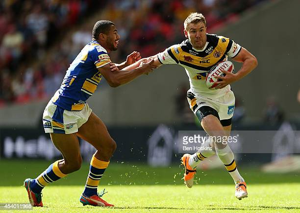 Michael Shenton of Castleford is tacked by Ryan Bailey of Leeds during the Tetley's Challenge Cup Final between Leeds Rhinos and Castleford Tigers at...